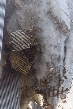 The Facade Falls    The latticework facing of the south tower came tumbling to earth upon impact of the hijacked plane.