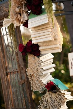 Book pages can be crafted into all sorts of garlands and decor. Photo by Studio EMP via Style Me Pretty