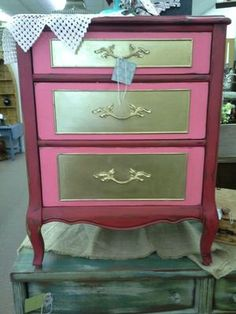 $60 - Classic lines on this 3 drawer chest. Unique 3 color paint, red , gold and pink. The chest measures 23 inches across the front, 18 inches deep. It stands 30 inches tall. It can be seen in booth D 8 at Main Street Antique Mall 7260 East Main St ( E of Power Rd ) Mesa 85207  480 9241122open 7 days 10 till 530 Cash or charge accepted