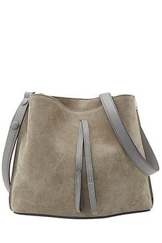 Understated but achingly cool, Maison Martin Margiela prides itself on minimal style with longevity. The compact silhouette and soft suede finish of this shoulder bag is effortless #Stylebop
