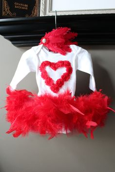 Valentine diva tutu set. Fur boa tutu onesie with rosette heart with matching goose feather headband. $75.