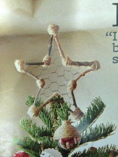 Christmas tree topper out if Chicken Wire.  Great DIY idea.