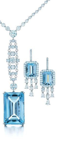 Color-saturated aquamarines and cascading diamonds shimmer like a waterfall. Platinum necklace and earrings from The Great Gatsby Collection.