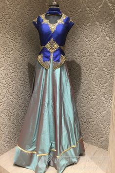<p>Create a smoldering impact by draping this Brilliant Olive Green Navy Blue silk Designer Readymade lehenga choli. Feature with zari, stone, cut danna on choli of front and backside with elegant plain kali lehega which will complete your look. Available with matchin net dupatta. Available Size is 36. For extra size kindly inquiry at +91 9377222211</p>