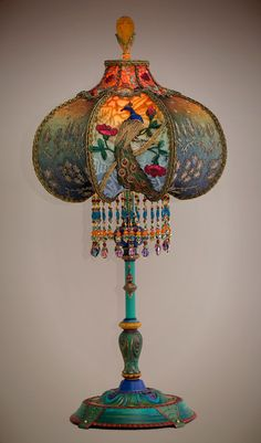Beautiful and unusual era table lamp with peacock feather motifs has been hand painted and holds a Peacock & Roses silk and beaded shade. bruce hates these but I like them, so maybe put them in guest house? Victorian Lamps, Antique Lamps, Victorian Furniture, Muebles Estilo Art Nouveau, Blind Art, Lampe Decoration, I Love Lamp, Lamp Shades, Bohemian Decor