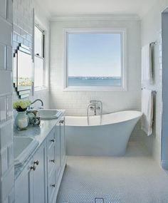 What a pretty bathroom . Love that tub.