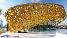 The Butterfly Pavilion features a golden roof that flows over a glass cube housing an artificial ecosystem and its rainforest biotope. Green Architecture, Concept Architecture, Pavilion Architecture, Chinese Architecture, Futuristic Architecture, Architecture Design, Rainforest Ecosystem, Butterfly Live, Butterflies