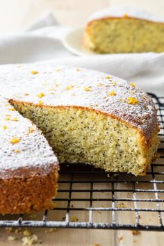 Yum! This Almond Olive Oil Cake is a rich melt-in-your-mouth cake that is moist and fluffy. The delightful scent of orange makes this a refreshing cake, and the poppy seeds give it a unique element. You may also want to call this an Orange Poppy Seed Cake. Recipe on www.theworktop.com. #Almondcake #oliveoilcake #breakfast #cakerecipe #poppyseeds