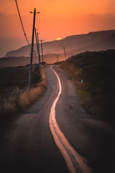 Winding road and sunset (Bolinas, California) by Larry Nienkark