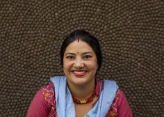 Meet Laxmi Chowdhari, she is part of our Sukhi team in Nepal.   At Sukhi, you'll never see shops with people crammed into tight spaces. There are two small Sukhi workshops set up in Kathmandu. We hire craftspeople that live within walking distance of our workshops. Often they are able to work from home and watch their children. When a maker finishes making a rug from home, she simply brings it into one of our Kathmandu shops.