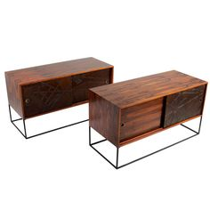 Set of Rosewood Bedside Tables with Leather Embossed Sliding Doors | See more antique and modern Night Stands at https://www.1stdibs.com/furniture/tables/night-stands