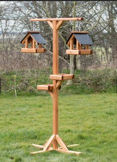 A rather unique and proving to be very popular twin bird table feeding station, dont the picture fool you this is an impressive structure Bird Feeder Stands, Bird Feeder Poles, Wood Bird Feeder, Bird House Feeder, Rustic Bird Feeders, Bird Feeder Hangers, Homemade Bird Houses, Homemade Bird Feeders, Bird Houses Diy