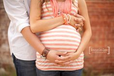 I really like the way they are standing and holding hands for this maternity shoot