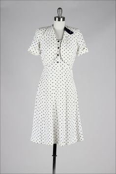 White linen dress with navy blue polka dots (with jacket), c. 1940s.