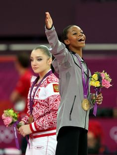 Gabrielle Douglas of the United States celebrates on the podium after winning the gold medal in the Artistic Gymnastics Women's Individual All-Around final on Day 6 of the London 2012 Olympic Games at North Greenwich Arena on August 2, 2012 in London, England.