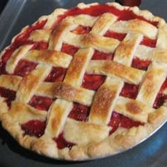 Strawberry Rhubarb Pie.  We have a huge rhubarb plant in the backyard that I will have to harvest for this