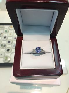 Ceylon sapphire baguette diamond with parvee set shoulders hand made engagement ring by diamondline jewellery
