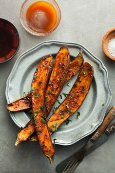 Honey and harissa roasted eggplant is sweet and spicy and deliciously creamy on the inside. // @gourmandeinthek
