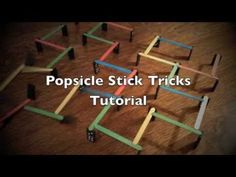 Dominoes and colored Popsicle sticks are a gateway to learning about Rube Goldberg machines!