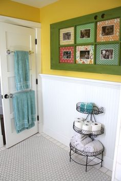 towel bars on the back of the door..hmm...I'd think unless you're planning on keeping the door closed, this wouldn't let the towels dry out....I like the multi-tiered basket for tp and hand towels though....very cute!