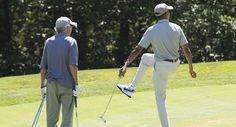 US President Barack Obama reacts to a putt alongside comedian Larry David (L) as they play golf at Farm Neck Golf Club in Oak Bluffs on Martha's Vineyard in Massachusetts, August 8, 2015. The Obama family is on a 2-week vacation. AFP PHOTO / SAUL LOEB        (Photo credit should read SAUL LOEB/AFP/Getty Images)