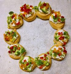 Christmas Wreath Appetizers - so easy, even the kids can help! | Recipe at SoupAddict.com #christmaswreath #appetizers #fingerfoods #holidayappetizers