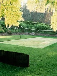 Carve out a special spot, planted with resilient turf (tall fescue or Bermuda grass) that contrasts with the surrounding lawn. To prevent the two from mingling, install metal or plastic edging around your court's perimeter. Then, maintain visual separation with a weekly mowing, at the lowest setting.