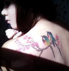 Great watercolor birds on cherry blossom branch tattoo, add an extra bird to make it a Three Little Birds tattoo.