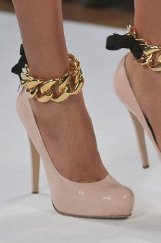 pink. patent. heels. gold ankle cuff. black bow.