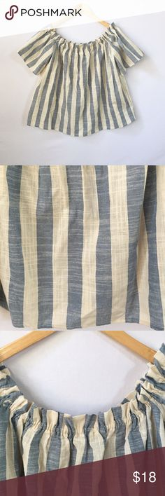 Striped Off the Shoulder Top Off the shoulder top with blue and white/cream vertical stripes. Gathered neckline. 100% cotton. Length from front neckline to hem - 20.75 inches. Underarm to underarm - approx. 20 inches. Love In Tops