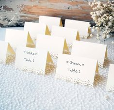 set of 100 standing ivory wedding place cards/escort cards rustic shabby chic. $100.00, via Etsy.