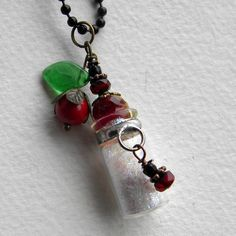 Fairy tale Necklace - SNOW WHITE - Once Upon A Time - Tiny Bottle with Apple Charm. $30.00, via Etsy.