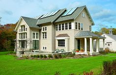 Bleaching oil finish Shingles by Maibec. Trim is painted with Benjamin Moore Sail Cloth Marvin Windows, Tim Beta, Window Replacement, Best Solar Panels, Solar House, Diy Solar, Solar Energy, Renewable Energy, Energy Efficiency
