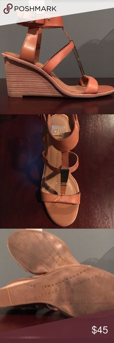 Dolce Vita Wedge Sandals These are super cute. I haven't worn them more than 5 times. There are a few dings on one of the shoes - shown in final pic - not sure how I did that but hardly noticeable when worn. Great gold hardware. Dolce Vita Shoes Wedges