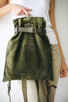 This Handmade Designer Bag is Convertible and super practical to use as a Cross Body Bag, a Backpack and a Shoulder bag. It is Vintage and Trendy Made from the Highest Quality Suede