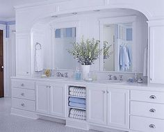Double Vanity with Arched Surround  A double-sink vanity can be ideal for a couple, providing space for both to use the area simultaneously.