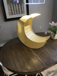 """""""I Love you to the moon and back..."""" This moon prop is a great accessory for any newborn/child photographer:) Handmade from wood, and painted in a variety of colours. Sizes of the moon is approximately 24""""x24""""x9"""" Custom leg allows adjustment of the moon angle to best suit your shot."""