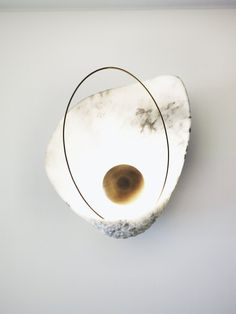 Ginger & Jagger—based in the city of Maia in Portugal—launched the Pearl wall lamp at the Milan Furniture Fair. The shell is hand-carved from a block of Carrara marble, while the light source is behind a curved piece of brushed brass. It sells for $4,205.