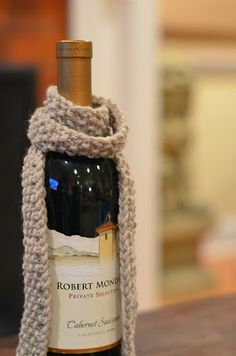 DIY- Knitted wine bottle scarf.  Super fast hostess gift!