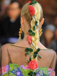 "over done(colorful)fabric flower's in extensions braid...the ""wow"" factor."