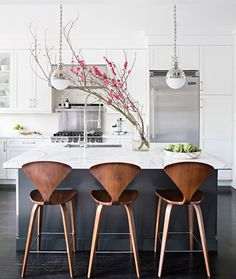 As we continue our kitchen renovation journey, we found some fantastic modern wood and leather counter stools for under $300.