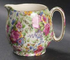 Google Image Result for http://images.replacements.com/images/images5/china/R/royal_winton_summertime_pre_1960_cream_background_gold_trim_countess_creamer_P0000088593S0467T2.jpg