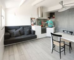 Architecture, Kitchen Living And Dining Room Very Small Apartment Design With White Interior Color Decorating Ideas Black Sofa Wooden Floor Tiles And Stainless Steel Backsplash: The Charming and Comfortable Harbour Attic by Gosplan Attic Design, Küchen Design, Interior Design, Simple Interior, Design Ideas, Small Apartment Design, Attic Apartment, Apartment Therapy, Tiny Apartments