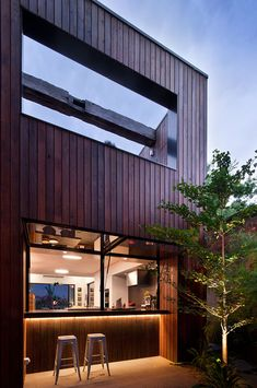 Recycled Beams, wood finish, kitchen in/outside bar (Fitzroy House | Techne)