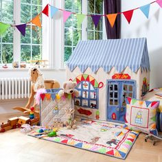 Open for business and packed with treats, embroidered and appliqued with colourful bunting, multi coloured dots and traditional toys. the toy shop range is a winner for both boys and girls. Made from extremely durable hand-woven and hand-dyed 100% cotton. Easy to assemble with a light metal frame. Storage bag included. Floor quilts for the playhouse are an optional extra and are sold separately. Available in two sizes: Large 134cm long x 110cm wide x 165cm high Small 110cm long x ...