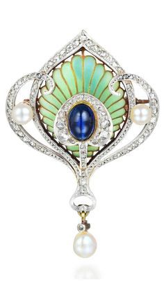 A beautiful Art Nouveau pin pendant in platinum with diamonds, plique-a-jour enamel, and a wonderful 1.85 ct cabochon sapphire.