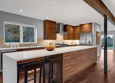 Remodeling a Mid-Century Modern House to Sell in Seattle – Hooked on Houses Midcentury modern kitchen – not a fan of white countertops, and there might be too much wood cabinetry, but this is close. Modern Kitchen Cabinets, Modern Kitchen Design, Kitchen Layout, Interior Design Kitchen, Kitchen Designs, Kitchen Island, Wood Cabinets, Narrow Kitchen, Open Kitchen