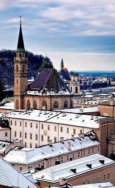The Franziskanerkirche in winter - Salzburg old town, Austria. ~ Müllnerkirche in the far background.