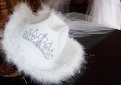 White felt cowgirl hat with close up of the tiaria that lights up with a switch inside the hat.  Used by Brides for Bacherlorette Parties. Sold at the Doubletree Hotel downtown Nashville and gottagottahaveit.com
