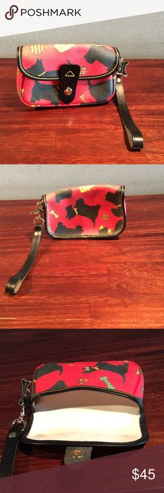 Dooney & Bourke Scotty Dog Wristlet. Dooney & Bourke Scottie Dog Wristlet. Slight discoloration on interior from rubbing against leather trim as shown in pictures. Dooney & Bourke Bags Clutches & Wristlets